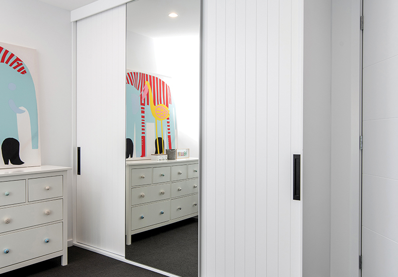 The Waterford built-in wardrobe with sliding doors represents design excellence